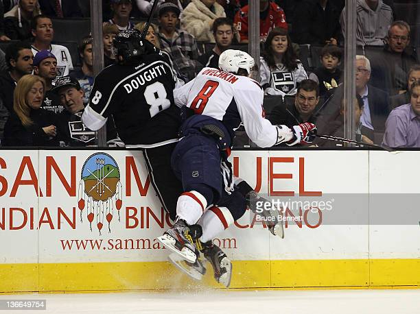 Alex Ovechkin of the Washington Capitals hits Drew Doughty of the Los Angeles Kings into the boards during the first period at the Staples Center on...