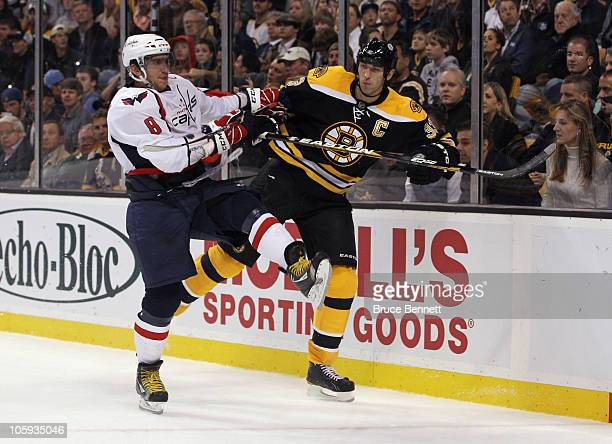 Alex Ovechkin of the Washington Capitals hits Zdeno Chara of the Boston Bruins at the TD Garden on October 21, 2010 in Boston, Massachusetts.