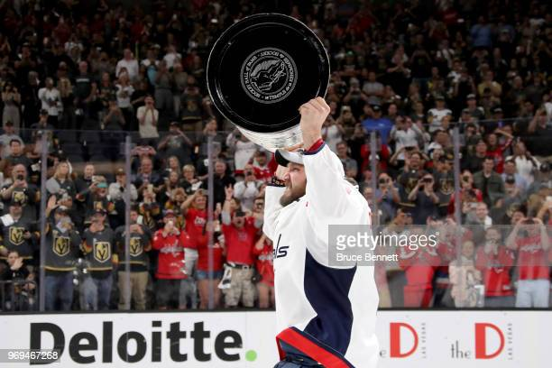 Alex Ovechkin of the Washington Capitals hoists the Stanley Cup after his team defeated the Vegas Golden Knights 43 in Game Five of the 2018 NHL...