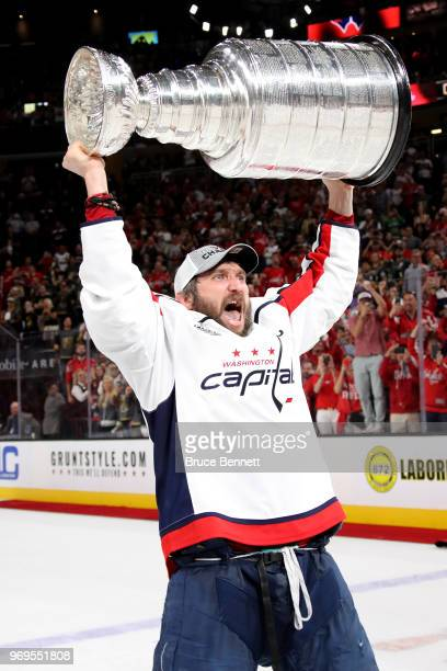Alex Ovechkin of the Washington Capitals hoists the Stanley Cup after his team defeated the Vegas Golden Knights 4-3 in Game Five of the 2018 NHL...