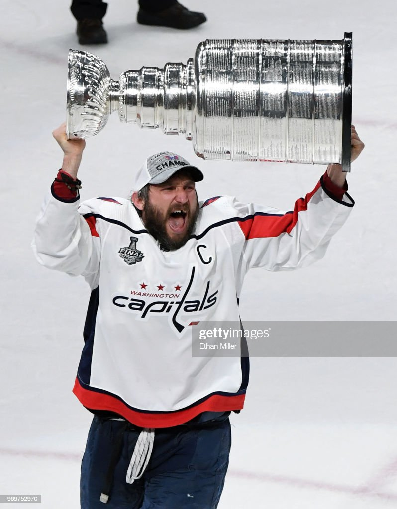Alex Ovechkin #8 of the Washington Capitals hoists the Stanley Cup after the team's 4-3 win over the Vegas Golden Knights in Game Five of the 2018 NHL Stanley Cup Final at T-Mobile Arena on June 7, 2018 in Las Vegas, Nevada.