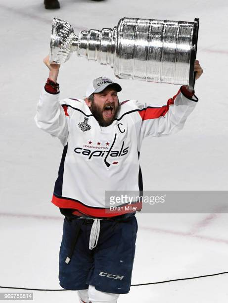 Alex Ovechkin of the Washington Capitals hoists the Stanley Cup after the team's 43 win over the Vegas Golden Knights in Game Five of the 2018 NHL...