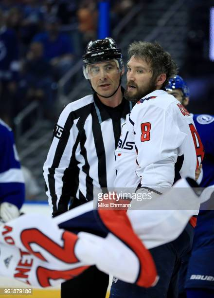 Alex Ovechkin of the Washington Capitals holds teammate Evgeny Kuznetsov jersey after a fight against the Tampa Bay Lightning during the first period...