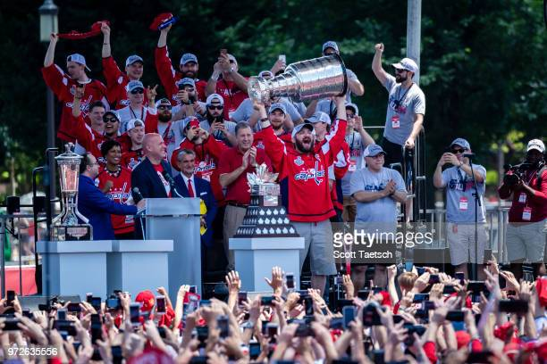 Alex Ovechkin of the Washington Capitals holds the Stanley Cup during the Washington Capitals Victory Parade and Rally on June 12 2018 in Washington...