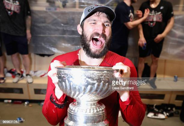 Alex Ovechkin of the Washington Capitals holds the Stanley Cup in the locker room after the Capitals defeated the Vegas Golden Knights 43 in Game...