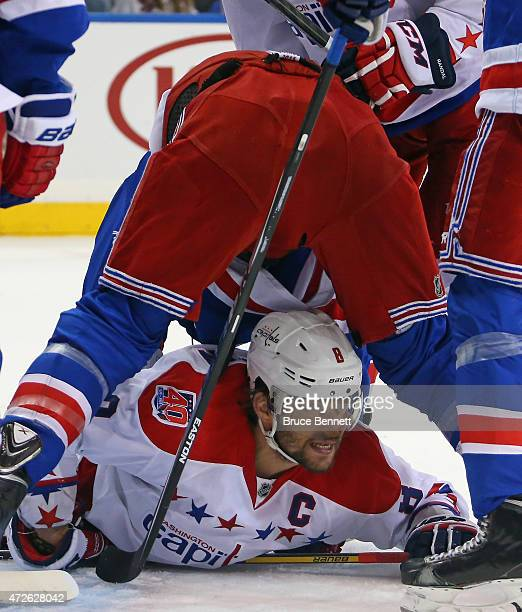 Alex Ovechkin of the Washington Capitals is checked by Marc Staal of the New York Rangers during the first period in Game Five of the Eastern...