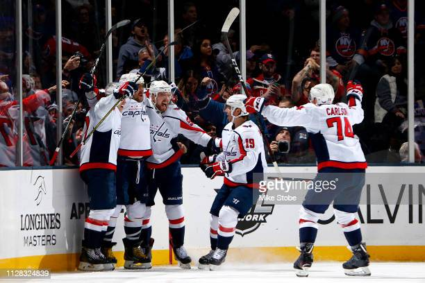Alex Ovechkin of the Washington Capitals is congratulated by his teammates after scoring a third period goal against the New York Islanders at NYCB...