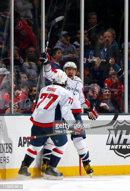 Alex Ovechkin of the Washington Capitals is congratulated by his teammate TJ Oshie after scoring a third period goal against the New York Islanders...