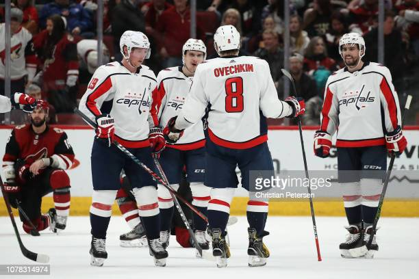Alex Ovechkin of the Washington Capitals is congratulated by teammates Nicklas Backstrom Dmitry Orlov and Matt Niskanen after Ovechkin scored an...