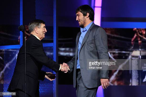 Alex Ovechkin of the Washington Capitals is congratulated by Ted Lindsay as he accepts the Ted Lindsay Award during the 2010 NHL Awards at the Palms...