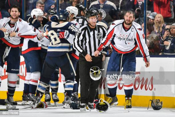 Alex Ovechkin of the Washington Capitals is led to the penalty box after fighting against the Columbus Blue Jackets on April 2 2017 at Nationwide...
