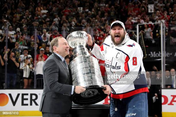 Alex Ovechkin of the Washington Capitals is presented the Stanley Cup by NHL Commissioner Gary Bettman after his team defeated the Vegas Golden...