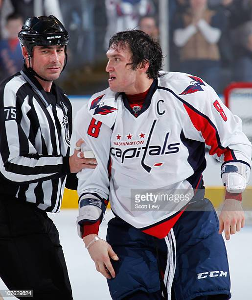 Alex Ovechkin of the Washington Capitals is pulled away from a fight against Brandon Dubinsky of the New York Rangers on December 12 2010 at Madison...