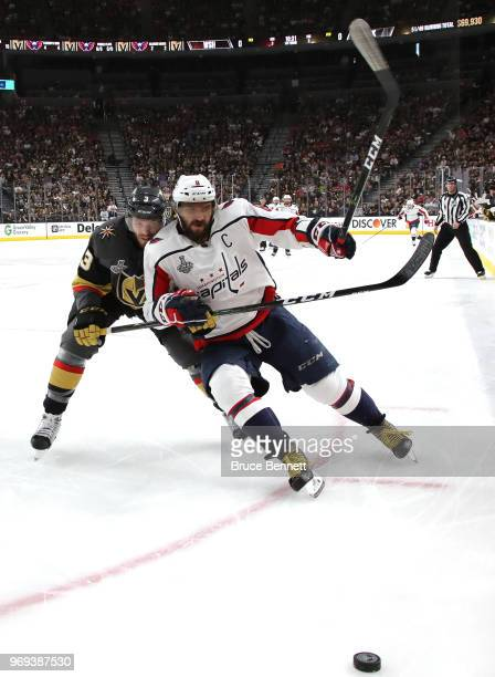 Alex Ovechkin of the Washington Capitals is pursued by Brayden McNabb of the Vegas Golden Knights during the first period in Game Five of the 2018...