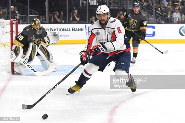 Alex Ovechkin of the Washington Capitals is pursued by Nate Schmidt of the Vegas Golden Knights during the first period in Game Two of the 2018 NHL...