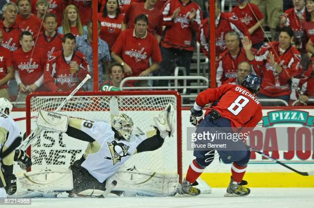 Alex Ovechkin of the Washington Capitals is stopped by MarcAndre Fleury of the Pittsburgh Penguins during first period action in Game Seven of the...