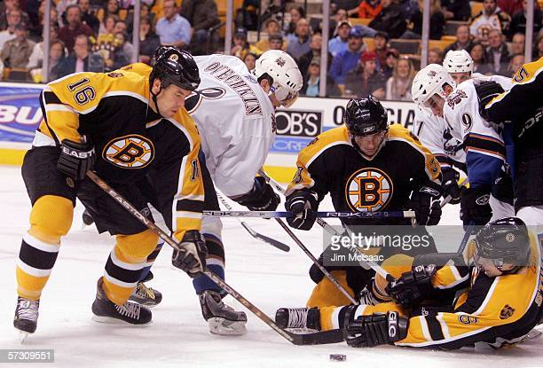 Alex Ovechkin of the Washington Capitals is surrounded by Marco Sturm Patrice Bergeron and Brad Stuart of the Boston Bruins as he fights for control...
