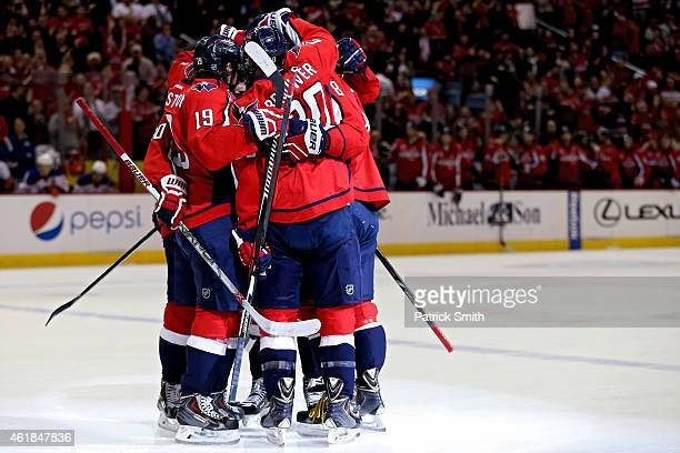 Alex Ovechkin of the Washington Capitals is surrounded by teammates after scoring his second goal of the first period against the Edmonton Oilers at...