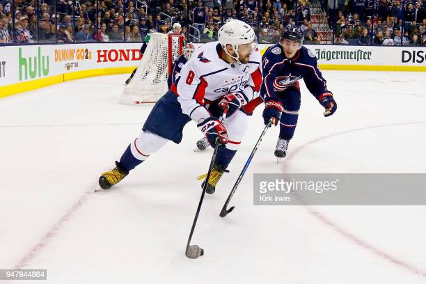 Alex Ovechkin of the Washington Capitals keeps control of the puck away from Zach Werenski of the Columbus Blue Jackets during the third period in...