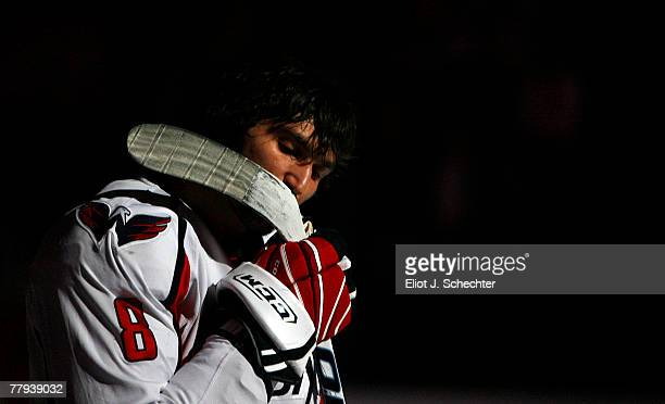 Alex Ovechkin of the Washington Capitals kisses his stick after the national anthem prior to the start of the game against the Florida Panthers at...