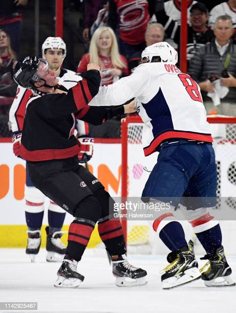 Alex Ovechkin of the Washington Capitals knocks out Andrei Svechnikov of the Carolina Hurricanes as they fight during the first period in Game Three...