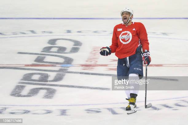 Alex Ovechkin of the Washington Capitals laughs during practice at MedStar Capitals Iceplex on July 17, 2020 in Arlington, Virginia. The team...
