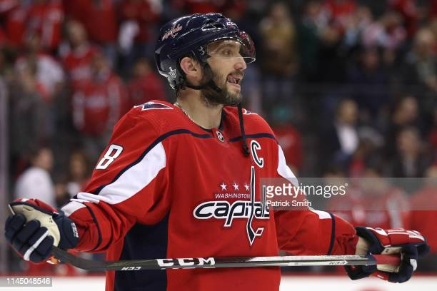 Alex Ovechkin of the Washington Capitals leaves the ice following a defeat by the Carolina Hurricanes in Game Seven of the Eastern Conference First...