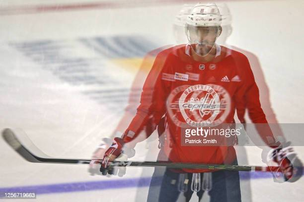 Alex Ovechkin of the Washington Capitals looks on during practice at MedStar Capitals Iceplex on July 17, 2020 in Arlington, Virginia. The team...