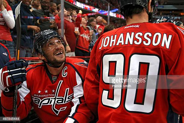 Alex Ovechkin of the Washington Capitals looks on from the bench after scoring a goal against the New Jersey Devils at Verizon Center on October 10...
