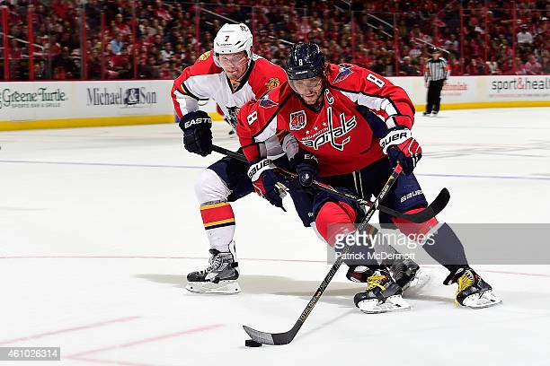 Alex Ovechkin of the Washington Capitals moves the puck up ice against Dmitry Kulikov of the Florida Panthers in the second period during an NHL game...