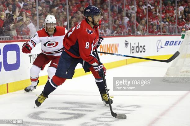 Alex Ovechkin of the Washington Capitals passes the puck for an assist to Brett Connolly of the Washington Capitals against the Carolina Hurricanes...