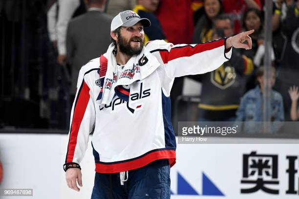 Alex Ovechkin of the Washington Capitals points to his teammates after being awarded the Conn Smythe Trophy after his team defeats the Vegas Golden...