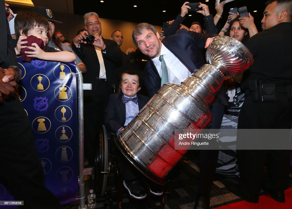 Alex Ovechkin of the Washington Capitals poses with a fan and the Stanley Cup at the 2018 NHL Awards presented by Hulu at the Hard Rock Hotel & Casino on June 20, 2018 in Las Vegas, Nevada.