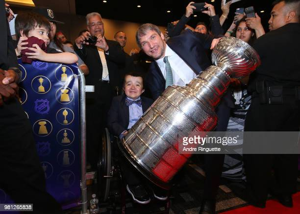 Alex Ovechkin of the Washington Capitals poses with a fan and the Stanley Cup at the 2018 NHL Awards presented by Hulu at the Hard Rock Hotel Casino...