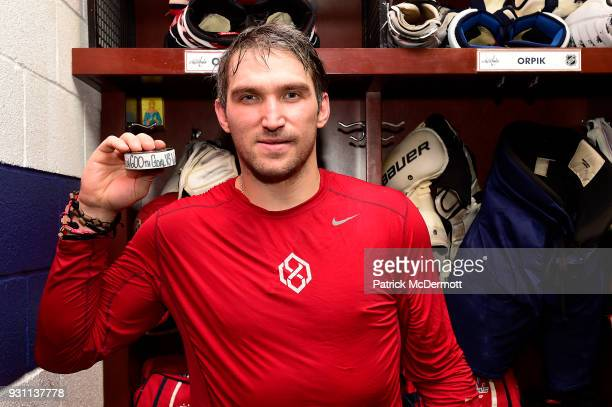Alex Ovechkin of the Washington Capitals poses with the puck commemorating his 600th career NHL goal that he scored during the second period against...
