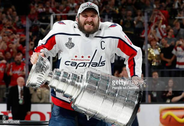 Alex Ovechkin of the Washington Capitals prepares to lift the Stanley Cup after his team defeated the Vegas Golden Knights 43 in Game Five of the...