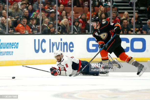 Alex Ovechkin of the Washington Capitals reaches for the puck as Josh Manson of the Anaheim Ducks follows during the first period at Honda Center on...