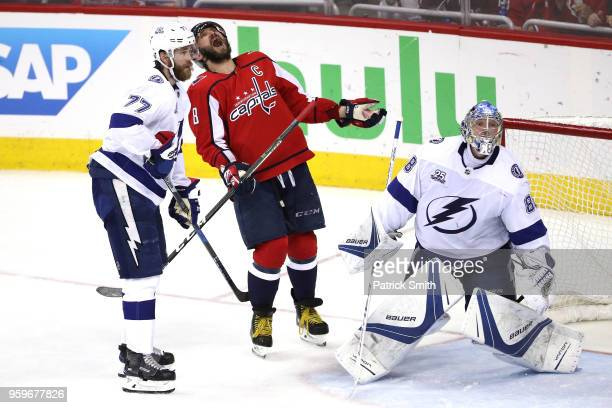 Alex Ovechkin of the Washington Capitals reacts after missing a shot against the Tampa Bay Lightning during the second period in Game Four of the...