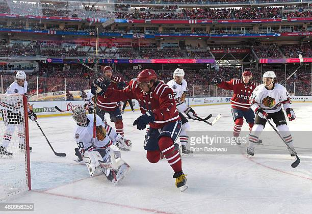 Alex Ovechkin of the Washington Capitals reacts after scoring a goal against goaltender Corey Crawford of the Chicago Blackhawks in the first period...