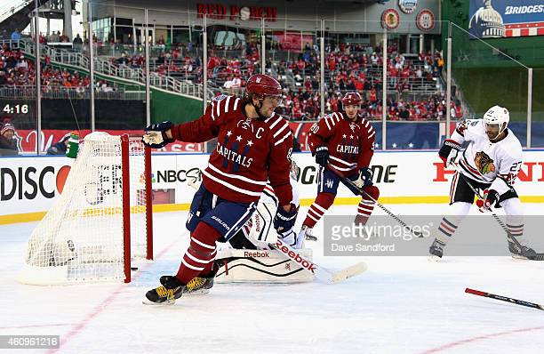 Alex Ovechkin of the Washington Capitals reacts after Troy Brouwer scored on goaltender Corey Crawford of the Chicago Blackhawks late in the third...
