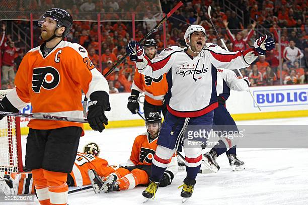 Alex Ovechkin of the Washington Capitals reacts in front of Claude Giroux of the Philadelphia Flyers after teammate TJ Oshie of the Washington...