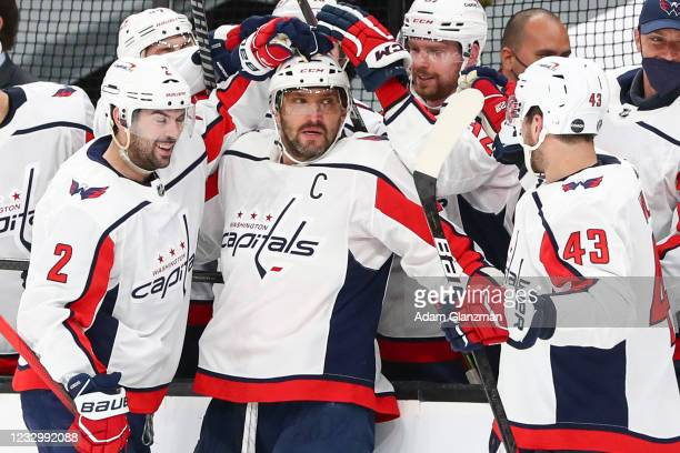 Alex Ovechkin of the Washington Capitals reacts with teammates after scoring in the second period in Game Three of the First Round of the 2021...