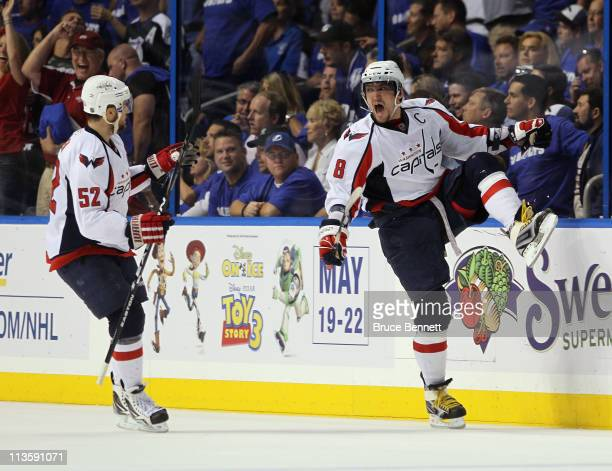 Alex Ovechkin of the Washington Capitals scores a power play goal at 17:27 of the second period against the Tampa Bay Lightning and is joined by Mike...