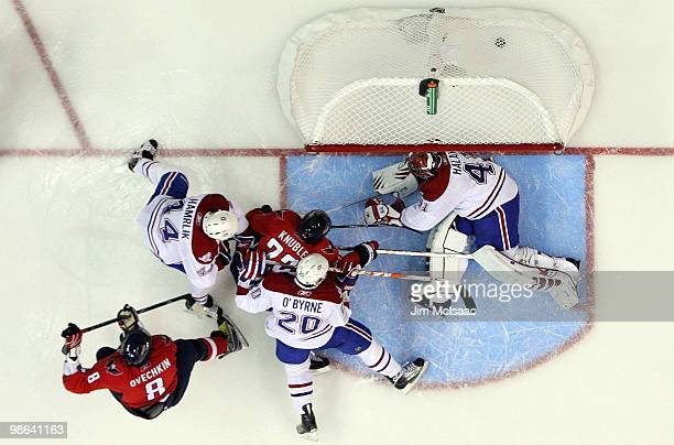 Alex Ovechkin of the Washington Capitals scores a second period goal past Jaroslav Halak of the Montreal Canadiens in Game Five of the Eastern...