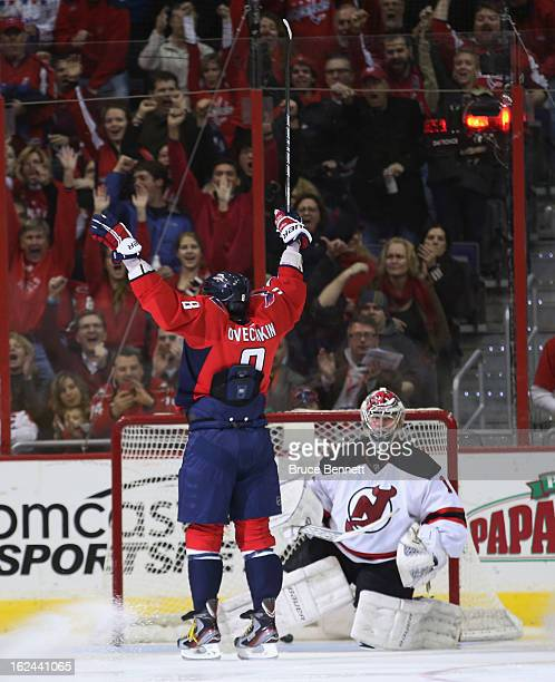 Alex Ovechkin of the Washington Capitals scores at 123 of the third period against Johan Hedberg of the New Jersey Devils at the Verizon Center on...