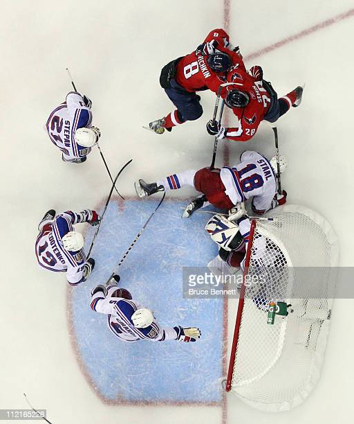 Alex Ovechkin of the Washington Capitals scores at 1344 of the third period to tie the score at 11 against the New York Rangers and celebrates with...