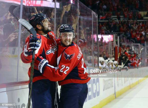 Alex Ovechkin of the Washington Capitals scores at 7:47 of the third period against the Pittsburgh Penguins and is embraced by Kevin Shattenkirk in...