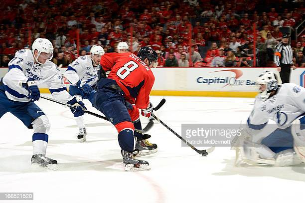 Alex Ovechkin of the Washington Capitals scores during the first period of an NHL game against the Tampa Bay Lightning at Verizon Center on April 13,...
