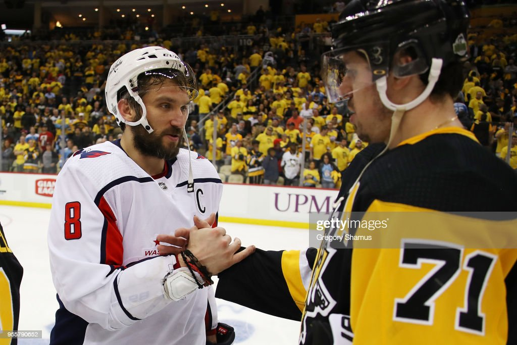 Alex Ovechkin #8 of the Washington Capitals shakes hands with Evgeni Malkin #71 of the Pittsburgh Penguins after a 4-2 Washington series win in the Eastern Conference Second Round during the 2018 NHL Stanley Cup Playoffs at PPG Paints Arena on May 7, 2018 in Pittsburgh, Pennsylvania.