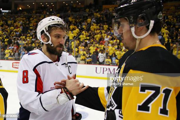 Alex Ovechkin of the Washington Capitals shakes hands with Evgeni Malkin of the Pittsburgh Penguins after a 42 Washington series win in the Eastern...